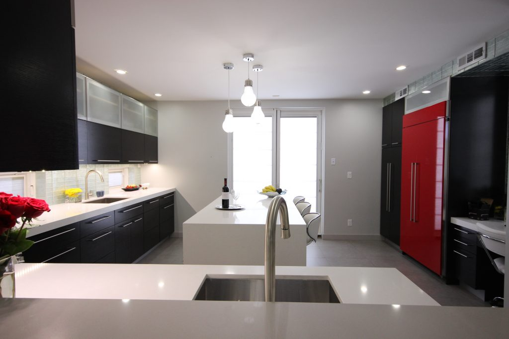 kitchen with red refrigerator